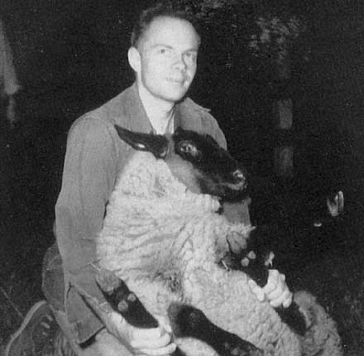 THIS IS A HANDOUT IMAGE. PLEASE VERIFY RIGHTS. KIPEN25-B-17JUN02-DD-HO --- Philip Dick with a sheep but no beard at his Point Reyes station home in the early sixties. PHOTO BY ANNE DICK FROM THE BOOK,