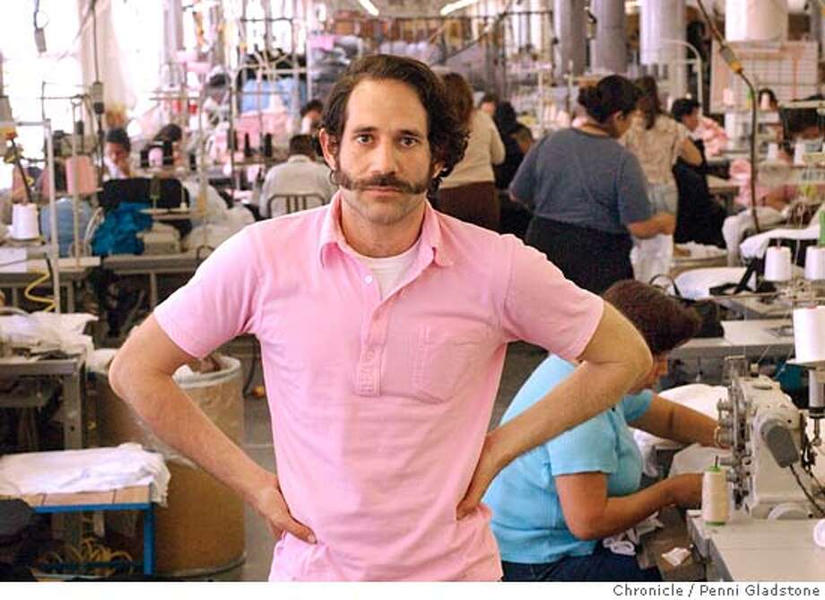 AMERICANAPPARELl190_pg.jpg  Standing among the workers is owner Dov Charney.  LA-based American Apparel is an $80-million-plus company that has spun its idealism into financial success and created a big exception to the rule in an industry where almost every piece of clothing is made overseas. American Apparel makes T-shirts, jackets and other casual wear -- every bit of it in a single factory in downtown LA. As Gap goes high-profile with its factory-monitoring program and much smaller companies make headway marketing their clothing as anti-sweatshop, American Apparel chugs along, paying its factory workers an average of $12 an hour (with such perks as workplace massages and free English courses). The firm's T-shirts sell briskly at boutiques in LA, New York and elsewhere. The company's attitudinal CEO and founder is outspoken about the so-called race to the bottom that has companies searching for the cheapest labor available, often at the expense of workers' rights. on 5/24/04 in Los Angeles, CA.  must credit photo by Penni Gladstone/ MANDATORY CREDIT FOR PHOTOG AND SF CHRONICLE/ -MAGS OUT Photo: Penni Gladstone