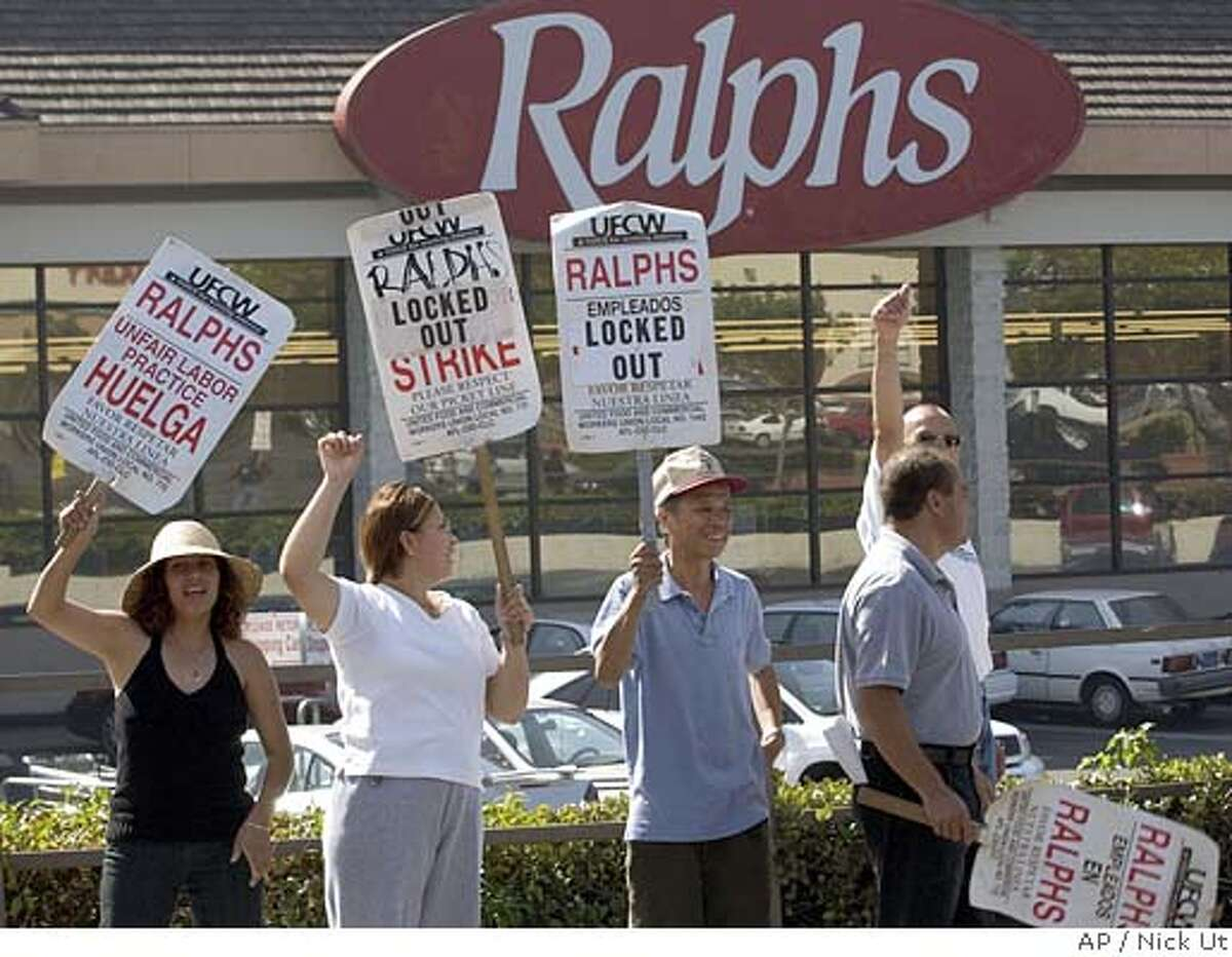 A group of grocery clerks demonstrate outside a Ralphs grocery store Friday, Oct, 17, 2003, in Los Angeles. Some 70,000 grocery clerks from three chains in the southern and central part of the state went on strike Sunday, along with grocery workers in four other states. The Teamsters union, which represents warehouse workers and tractor-trailer drivers, agreed to honor the picket lines. In a separate labor dispute, over 8,000 Metropolitan Transportation Authority employees went on strike Tuesday. (AP Photo/Nick Ut) Grocery clerks demonstrate outside a Ralphs supermarket in Los Angeles. About 70,000 clerks from three supermarket chains in southern and central California went on strike Sunday after talks with the chains management broke down. In a separate labor dispute, more than 8,000 Metropolitan Transportation Authority employees went on strike Tuesday, shutting down L.A. mass transit. CAT Nation#MainNews#Chronicle#10/18/2003#ALL#3star##0421444415