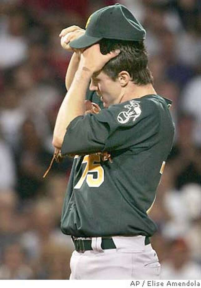 Oakland Athletics starting pitcher Barry Zito reacts on the mound after giving up two runs with bases loaded walks against the Boston Red Sox during the fourth inning at Fenway Park in Boston Tuesday, July 6, 2004. (AP Photo/Elise Amendola) Photo: ELISE AMENDOLA