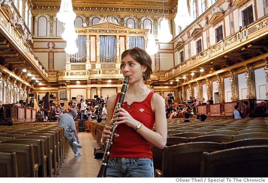 Tour diary writer Jeannie Psomas at a rehearsal, warming up her clarinet in the famed Musikverein, home of the Vienna Philharmonic. Oliver Theil / Special To The Chronicle Photo: Oliver Theil