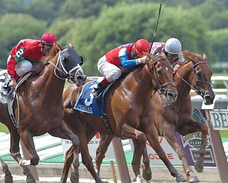 Peace Rules captures The Suburban Stakes at 7/3/04...Ridden by Jerry D. Bailey...Newfoundland (#3) was second with jockey John R. Velazquez....Funny Cide was third with jockey Jose Santos up.....