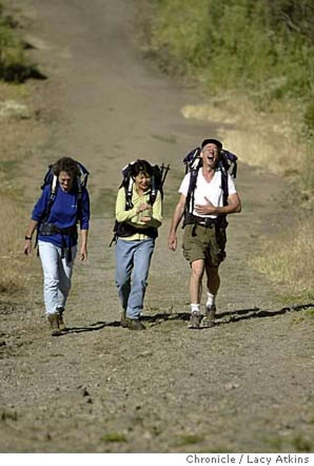 Dorian Newton, Pamela Low and Stuart Kandell, enjoy a laugh as they train for their climb of Mount Shasta at Sibley Park in Oakland, June 16, 2004. Their plan to do the climb in July.  LACY ATKINS / The Chronicle Photo: LACY ATKINS
