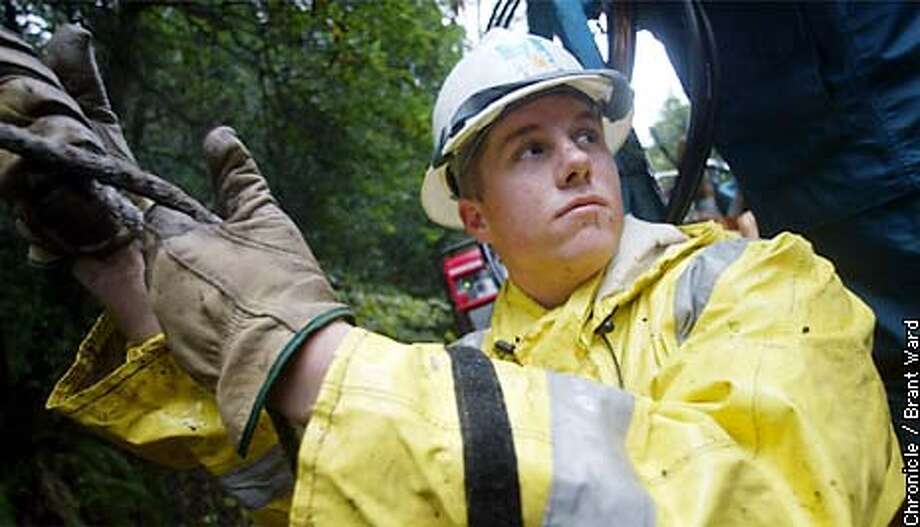 Shawn Ryan, who works for the PG&E crew in West Marin is worried about having to work Christmas...even though he will make a lot of overtime, he'd rather have a bit of time off after all the hours he has just worked. By Brant Ward/Chronicle Photo: BRANT WARD