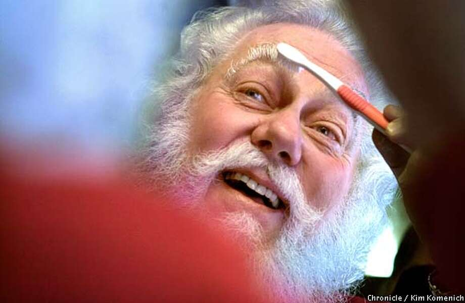 George Goetz, 66, grooms his eyebrows before going out for the day. During the holiday season, he makes as many as four appearances a day as St. Nick. Chronicle photo by Kim Komenich