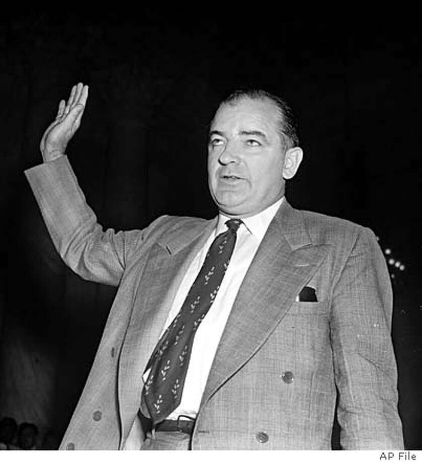 "** FILE ** Sen. Joseph McCarthy, R-Wis., takes the witness stand to testify at the Army-McCarthy hearings in this June 9, 1954 file photo in Washington. The hearings of Spring 1954 have been called ""the first great made-for-TV political spectacle."" (AP Photo/File) JUNE 9, 1954 FILE PHOTO"