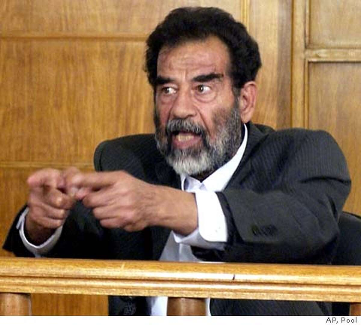 """Iraq's deposed dictator Saddam Hussein appears before an Iraqi tribunal in Baghdad, July 1, 2004. Downcast but defiant, Iraq's deposed dictator appeared before an Iraqi tribunal on Thursday, refusing to recognize its authority and saying the """"real criminal"""" was U.S. President George W. Bush. REUTERS/HO"""
