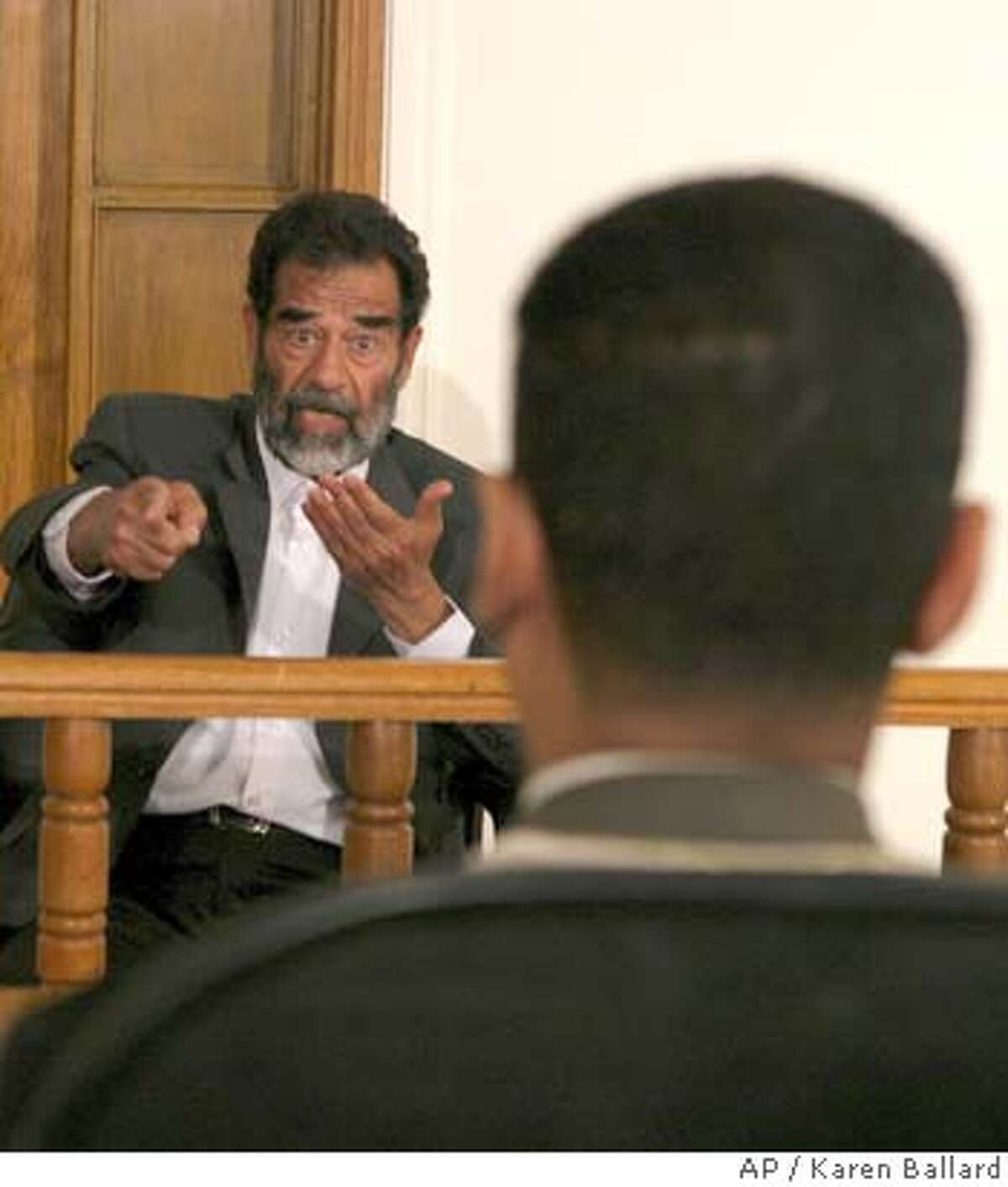 In this image cleared by the US military, Saddam Hussein appears in a courtroom at Camp Victory, a former Saddam palace on the outskirts of Baghdad, Thursday, July 1, 2004. (AP Photo/Karen Ballard/Pool)