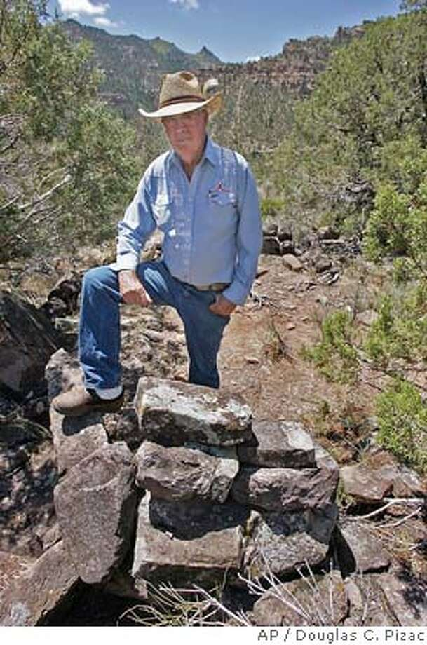 Waldo Wilcox poses in the remains of an ancient Indian pit house Wednesday, June 30, 2004, in the Range Creek area southeast of East Carbon City, Utah. Wilcox sold his ranch to the state so all the Indian artifacts could be preserved. (AP Photo/Douglas C. Pizac) Photo: DOUGLAS C. PIZAC