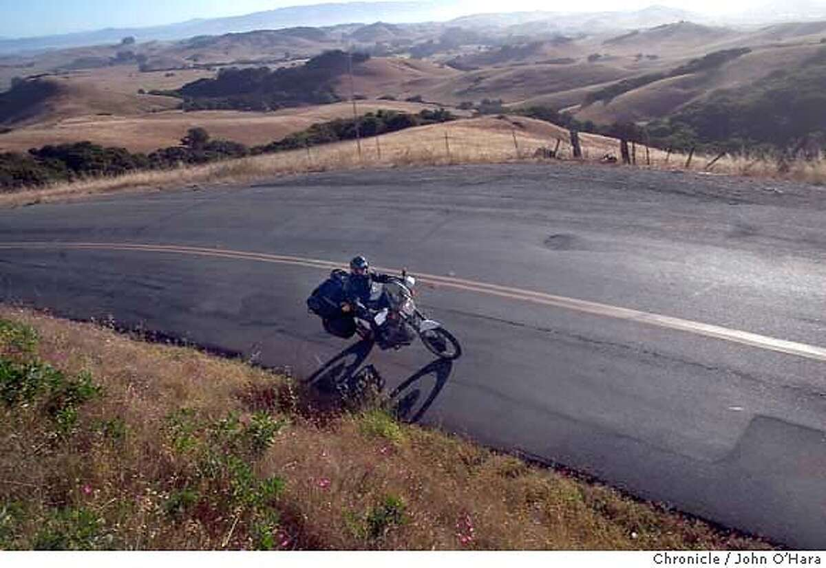 A file photo of Point Reyes-Petaluma Road. Mark Rafferty was arrested Monday on suspicion of assault with a deadly weapon following the angry encounter with a bicyclist on the road Tuesday.