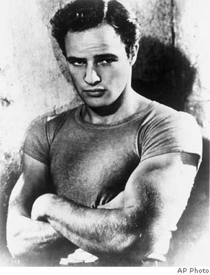 "**FILE**Actor Marlon Brando as Stanley Kowalski in this file photo from the 1951 film, ""A Streetcar Named Desire"". Brando, who revolutionized American acting with his Method performances in ""Streetcar Named Desire"" and ""On the Waterfront"" and went on to create the iconic characterization of Don Vito Corleone in ""The Godfather,"" has died, his lawyer said Friday, July 2, 2004. He was 80.(AP Photo)"