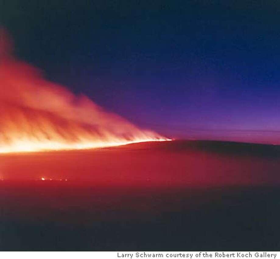 Prairie Fire Near Cottonwood Falls, Kansas, 1997  chromogenic print � Larry Schwarm, Courtesy the Robert Koch Gallery Photo: Larry Schwarm