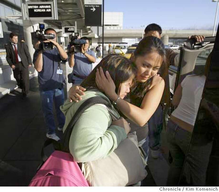 Donna Cuevas is comforted by Joanna Martinez as she arrives at SFO on her way to her new country.  Continuing coverage of the deportation of the Cuevas family of Fremont. The Cuevas family arrives at San Francisco International Airport and balances media interviews with checking in for a flight to Manila  Photo by Kim Komenich in Fremont. Photo: Kim Komenich