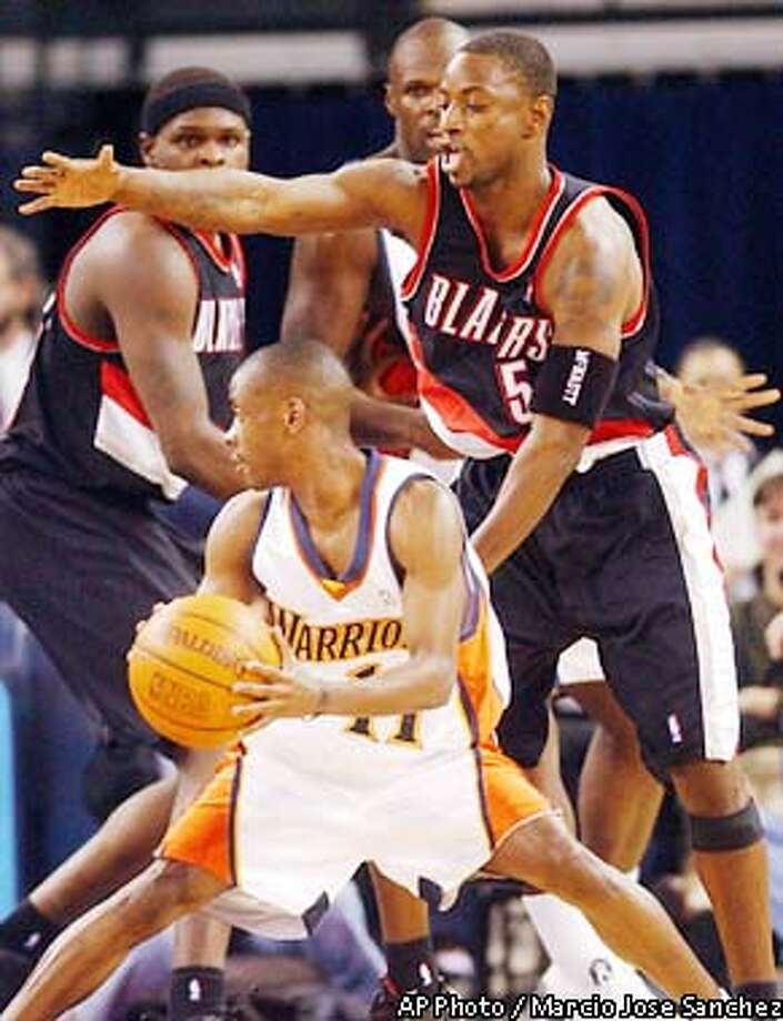 Portland Trail Blazers guard Jeff McInnis, top, defends on Golden State Warriors guard Earl Boykins, bottom, during the first quarter on Friday, Dec. 20, 2002 in Oakland, Calif. (AP Photo/Marcio Jose Sanchez) Photo: MARCIO JOSE SANCHEZ