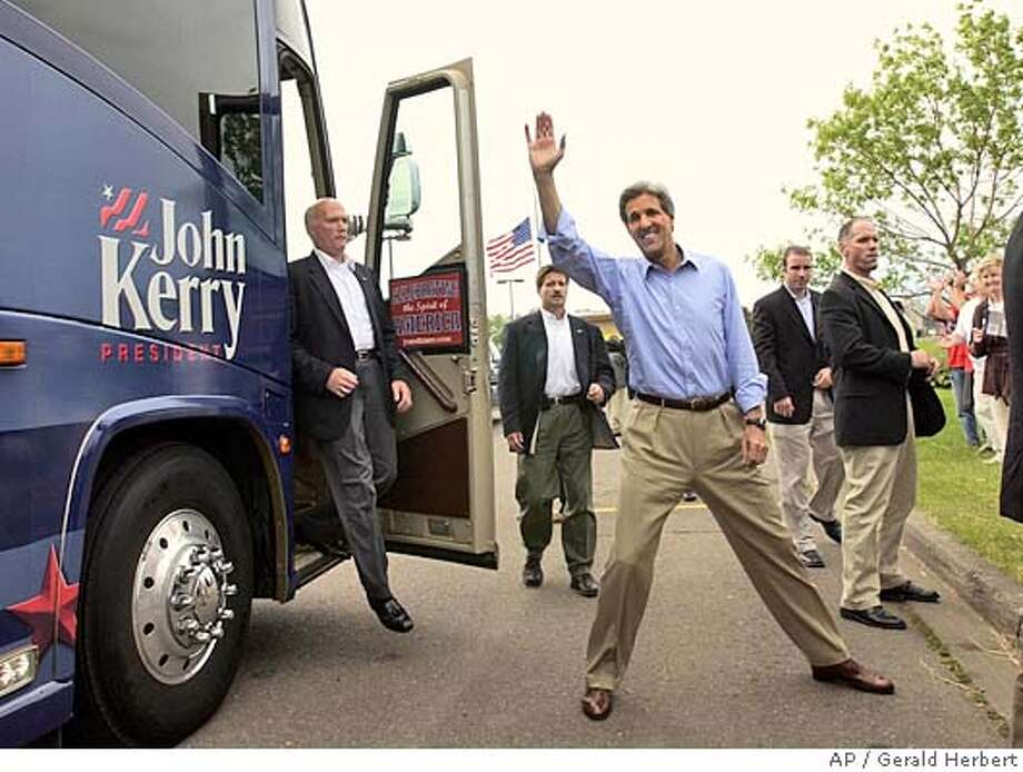 Democratic Presidential hopeful Sen. John Kerry, D-Mass. waves as he gets off his bus to greet supporters during an unscheduled stop in Superior, Wis. on Friday, July 2, 2004 (AP Photo/Gerald Herbert) Photo: GERALD HERBERT