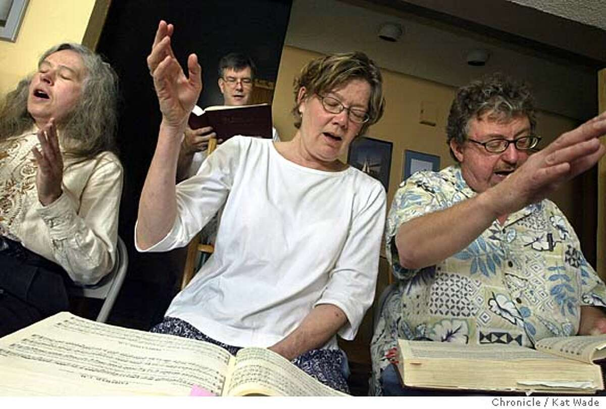 """Sacred Harp group, tenors, (L to R) Betty Marvin, Dan Curtis, Carolyn Deacy and David Fetcho sing their hearts out in the home of Dan Curtis and Rita Derbas, in Newark on 6/13/04 with their group Shape Notes. Sacred Harp groups with roots back to colonial times have become increasingly popular since they were featured in the """"Cold Mountain"""" film and soundtrack. Kat Wade/The Chronicle"""