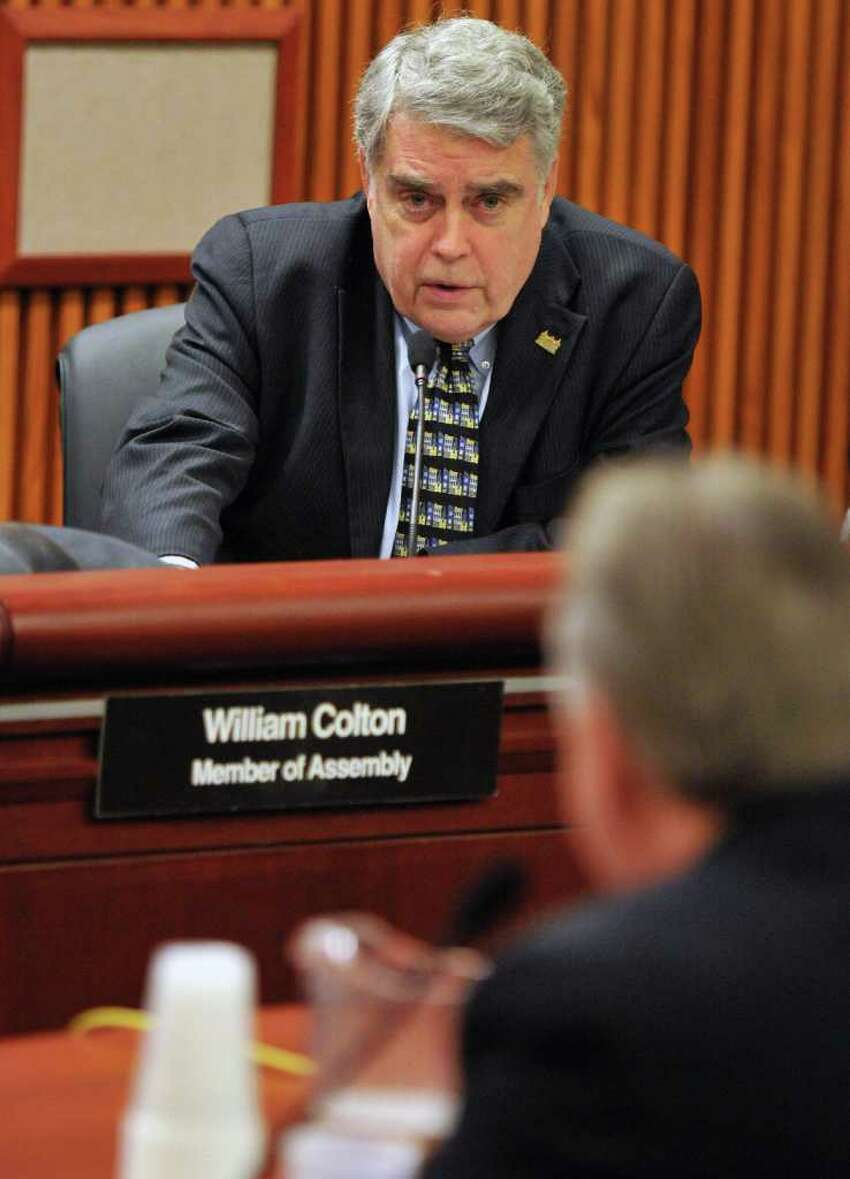 Assemblyman Jack McEneny, top, questions NYS Correction Officers Benevolent Assoc. president Don Rowe during a joint legislative budget hearing on workforce issues at the Capitol Wednesday Jan. 25, 2012. (John Carl D'Annibale / Times Union)