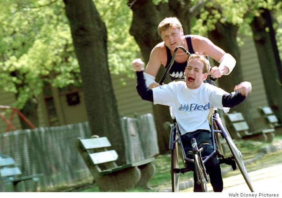 """Rick & Dick Hoyt � Boston Marathon (Boston, Massachusetts). �When I was born, the doctors told my parents to put me in an institution. I am lucky that my parents did not do that, or I might not have been able to be here today.� Rick was born in 1962 as a spastic quadriplegic, cerebral palsy, non-speaking person. Rick is a graduate of Boston University. Dick, his father, has recently retired as a lieutenant colonel in the air national guard. He has served his country for over thirty-five years. �The special bond developed between Rick and I when he was first born, and we started doing everything together. I wouldn�t be running today if Rick didn�t ask me to. Rick is the athlete and I�m just out there loaning him my arms and my legs, so that he can compete like everybody else. Rick is the heart and mobility is freedom.� fot the film """"antimoore30,"""" HANDOUT"""