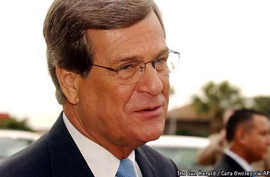 Senate Republican leader Trent Lott, R-Miss., talks to reporters after speaking to the Biloxi Chamber of Commerce, Wednesday Dec. 18, 2002, in Biloxi, Miss. Lott, fighting to surmount a furor over his racially insensitive remarks, complained Wednesday about anonymous White House leaks calling for his demise. ``There seems to be some things that are seeping out that have not been helpful,'' Lott said after the speech in Biloxi. (AP Photo/The Sun Herald, Cara Owsley) Photo: CARA OWSLEY