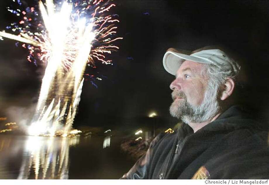 Event on 7/1/04 in San Rafael.  Jeff Thomas watches his fireworks show at the Marin county Fair. Jeff Thomas makes a living blowing stuff up. He is the producer of more than 60 fireworks shows planned over the Fourth of July weekend. Here he is at the fireworks show he is coordinating at the Marin County Fair. Liz Mangelsdorf / The Chronicle Photo: Liz Mangelsdorf