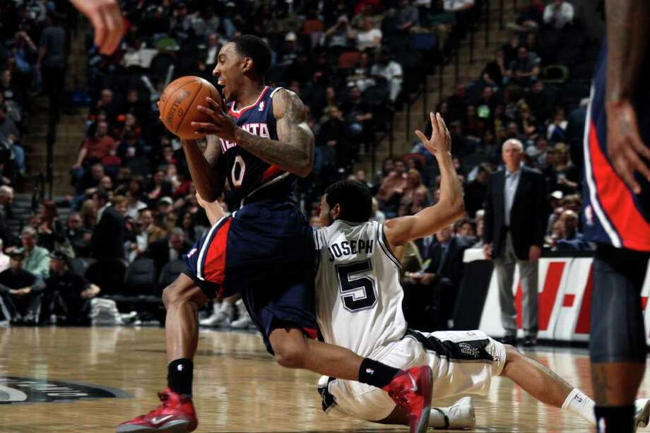 Atlanta Hawks guard Jeff Teague is fouled by San Antonio Spurs guard Cory Joseph after stealing the ball during the second half at the AT&T Center, Wednesday, Jan. 25, 2012. The Spurs won 105-83. Jerry Lara/San Antonio Express-News Photo: Jerry Lara, Express-News / © San Antonio Express-News