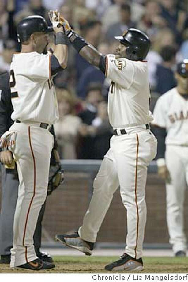 Event on 7/2/04 in San Francisco.  Giant Ray Durham is congratulatede at home plate by Duan Mohr after Durham's 2nd home run of the game in the 6th inning. San Francisco Giants host the Oakland A's at SBC stadium.  Liz Mangelsdorf / The Chronicle Photo: Liz Mangelsdorf