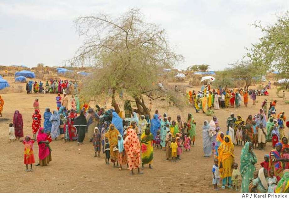 Sudanese displaced women at the Zam Zam refugee camp just outside the town of El-Fashir in the Darfour region of Sudan, Thursday July 1, 2004 during a visit by U.N. Secretary General Kofi Annan. Annan went to the Darfur province in western Sudan on Thursday to visit some of the camps serving as temporary shelters for civilians displaced by a vicious ethnic struggle that began 16 months ago. An estimated 1 million black Africans have been displaced during the conflict with Arab militias backed by the Sudanese government. (AP Photo/Karel Prinsloo) Photo: KAREL PRINSLOO