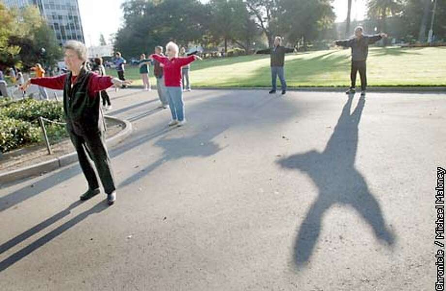 Over a hundred seniors gather every morning at Central Park for stretching and exercise including 75 year old retired nurse Anne Peter (center, red jacket NOTE : Peter is quoted in story). San Mateo has become a mecca for seniors with it's senior friendly downtown area. In fact there are more seniors living in San Mateo than any other peninsula city.  CHRONICLE PHOTO BY MICHAEL MALONEY Photo: MICHAEL MALONEY
