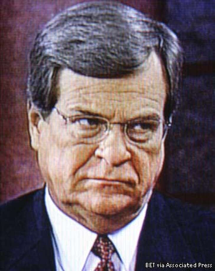 ** RETRANSMITTED TO CLARIFY RESTRICTIONS TO ONLINE AND TELEVISION ** In an image from television, Sen. Trent Lott, R-Miss., is interviewed on Black Entertainment Television from the studio of a CBS affiliate in Mobile, Ala., Monday, Dec. 16, 2002. The Senate GOP leader is trying to recover from insensitive remarks he made at Sen. Strom Thurmond's 100th birthday party earlier this month where he praised Thurmond's run for the presidency as a segregationist in 1948. (AP Photo/J. Scott Applewhite) Photo: J. SCOTT APPLEWHITE