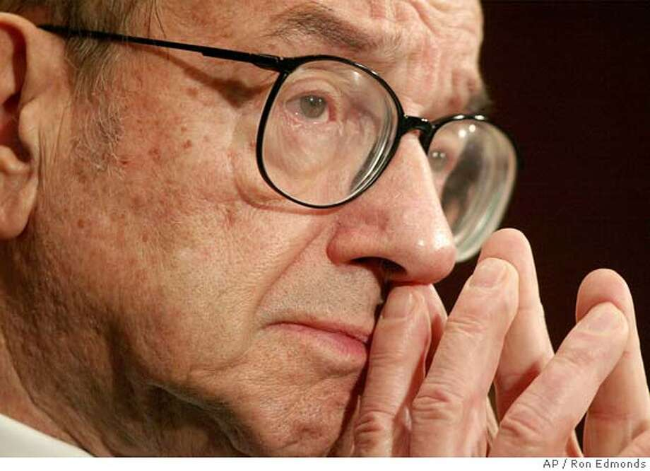 Federal Reserve Board Chairman Alan Greenspan testifies on Capitol Hill Tuesday, Feb. 24, 2004 before the Senate banking Committee. Greenspan said mortgage giants Fannie Mae and Freddie Mac could pose a threat to the country's financial system if their debt is not restrained, and urged Congress to consider capping the debt the two Fortune 500 companies can carry. (AP Photo/Ron Edmonds) Photo: RON EDMONDS