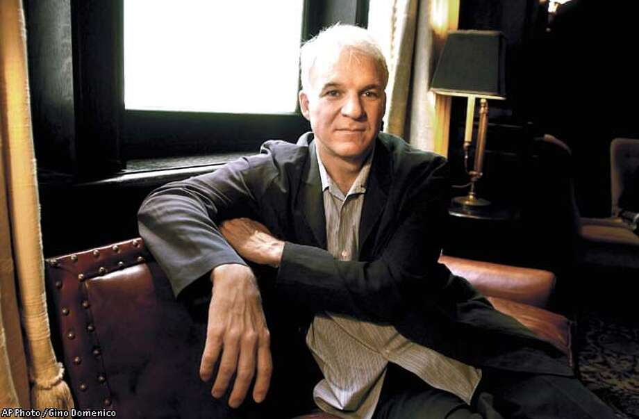 "ADVANCE FOR WEEKEND EDITIONS, OCT. 5-8--Comedian Steve Martin sits for a portrait in the lounge of the Algonquin Hotel in New York, Sept. 21, 2000. Martin, 55, has completed a book, the novella ""Shopgirl,"" an intimate study of three single people living in Los Angeles. AP Photo / Gino Domenico Photo: GINO DOMENICO"