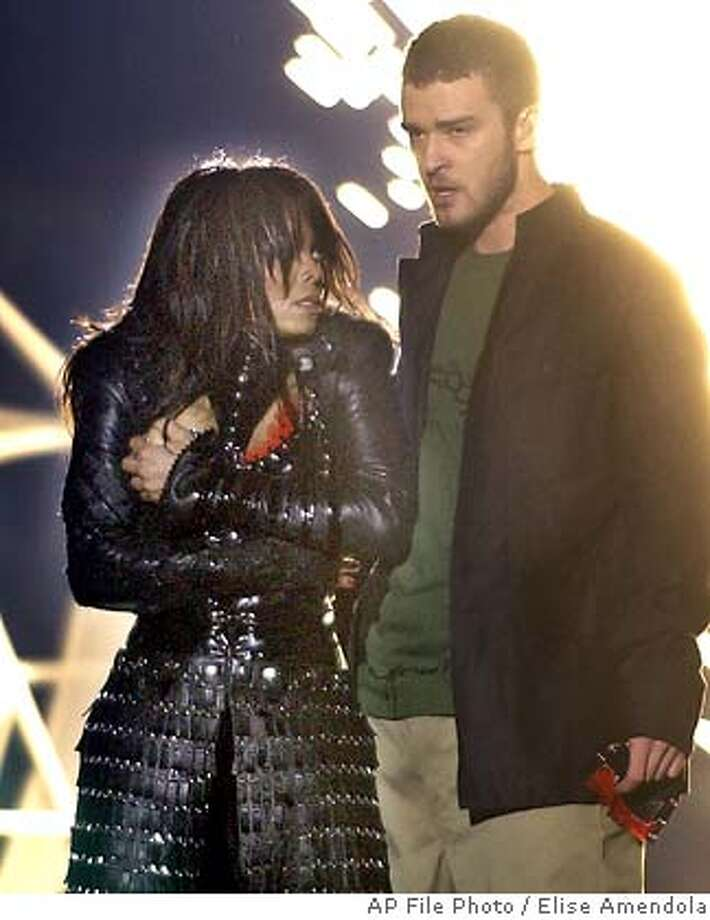 Singer Janet Jackson, left, covers her breast after her outfit came undone during a number with Justin Timberlake during the halftime show of Super Bowl XXXVIII in Houston, Sunday, Feb. 1, 2004. (AP Photo/Elise Amendola)  ALSO RAN: 2/3/2004  Undone: Janet Jackson and Justin Timberlake are apologizing for what they insist was an accidental exposure of her breast during the halftime show. &quo;Taboo Tunes&quo; by Peter Blecha, below: false alarms? &quo;Taboo Tunes&quo; by Peter Blecha, below: false alarms? Photo: ELISE AMENDOLA
