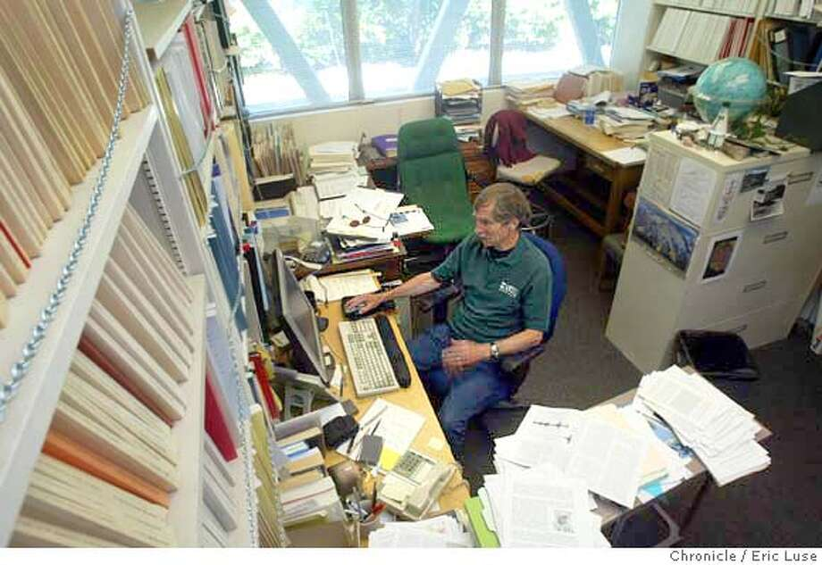 Davic Hill, UCGS Seismologist in his Menlo Park office complete with chains infront of the books for earthquake safety. Hill task is monitoring the the Long Valley Volcano Observation from sensors that he can view from his computer. Long Valley is near Mammoth Lakes.  USGS Menlo Park celebrates a 50 year anniversary.  Eric Luse / The Chronicle Photo: Eric Luse