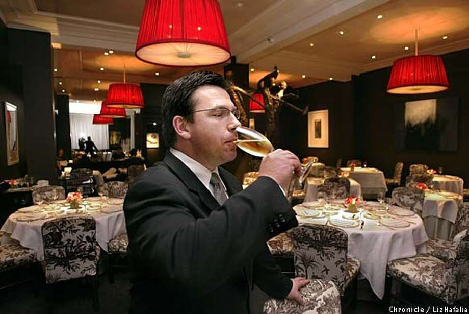 Fit To Be Served: Masa's sommelier Alan Murray tries a glass of Gosset Champagne, a current staff favorite. Chronicle photo by Liz Hafalia