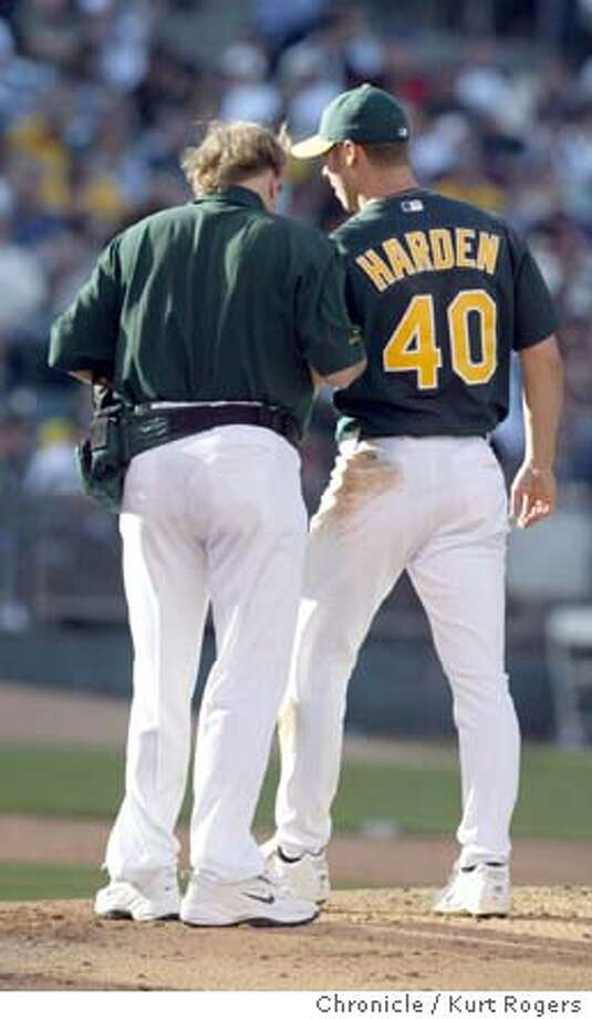 The a's trainer takes Rich Herden out of the game after injuring his arm.  The San Francisco Giants Vs. The Oakland A's in Oakland . 6/26/04 in Oakland,CA.  Kurt Rogers/The Chronicle Photo: Kurt Rogers