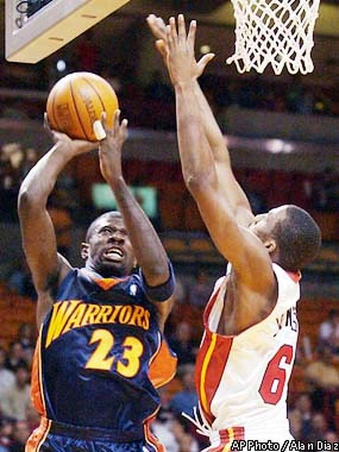 Miami Heat's Eddie Jones, right, blocks Golden State Warriors' Jason Richardson, left, in the first quarter, Saturday, Dec. 14, 2002 at the American Airlines Arena in Miami. (AP Photo/Alan Diaz) Photo: ALAN DIAZ