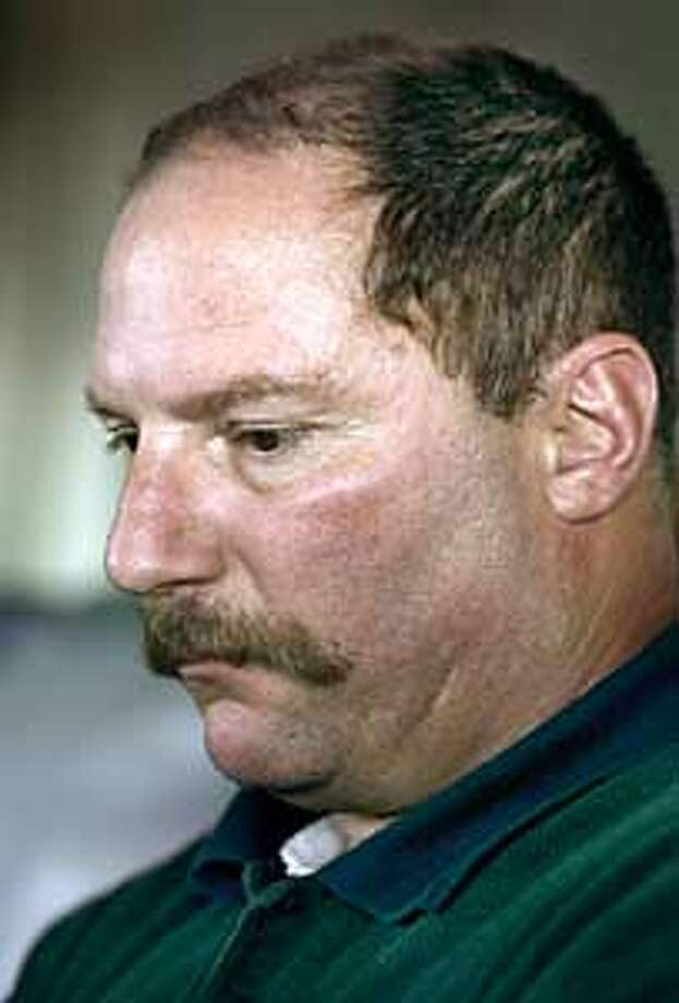 RINEKSTORY1-C-11NOV02-MT-FRL: FBI agent Jeff Rinek who solved the Yosemite murder case. When Rinek took Cary Stayner's confession it should have been the highlight of his career. But he had already lost faith in the agency he had taken pride in serving. And he discovered he had compassion for the man inside the monster. Lori, his wife, poses with him at their Serria foothill home in East Sacramento town of Rescue. Chronicle photo by Frederic Larson