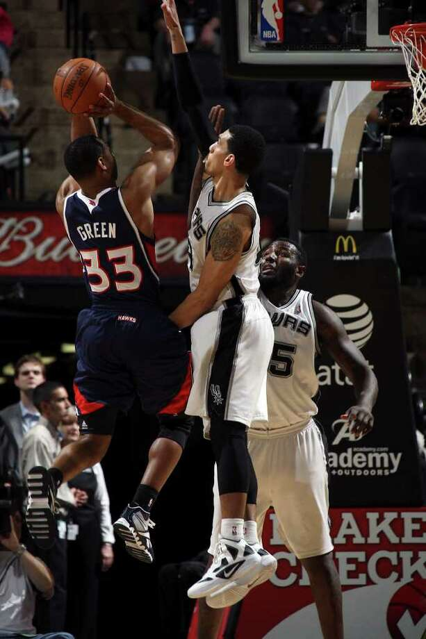 Spurs Danny Green, center, and DeJuan Blair defend against Atlanta Hawks Willie Green during the second half at the AT&T Center, Wednesday, Jan. 25, 2012. The Spurs won 105-83. Jerry Lara/San Antonio Express-News Photo: Jerry Lara, Express-News / © San Antonio Express-News