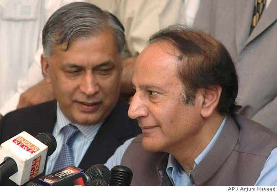 Future prime minister of Pakistan Shaukat Aziz, left, and interim prime minister Chaudhry Shujaat Hussain address a joint news conference on Saturday, July 26, 2004 in Islamabad, Pakistan. Prime Minister Zafarullah Khan Jamali announced his resignation and the dissolution of his Cabinet on Saturday, after months of speculation that his relationship with the country's military ruler was strained. Hussain will be a caretaker prime minister and would eventually give way to current Finance Minister Shaukat Aziz, a senator who must gain a seat in the lower house of Parliament before he can be nominated. (AP Photo/Anjum Naveed) Photo: ANJUM NAVEED