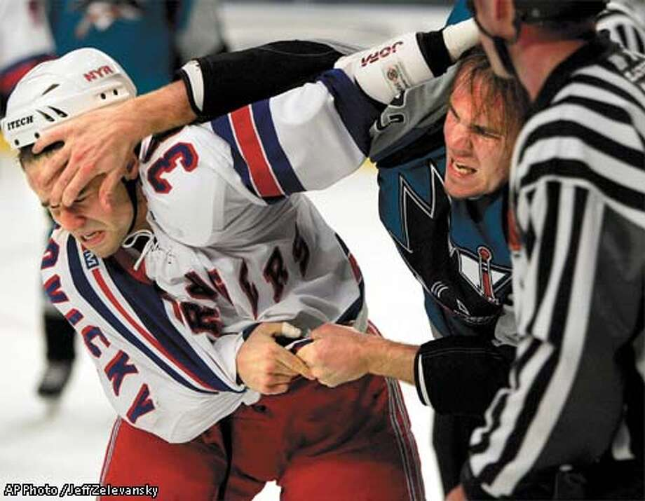 New York Rangers'' Ronald Petrovicky fights with San Jose Sharks' Scott Hannan in the second period of the Rangers 2-1 overtime win at Madison Square Garden in New York, Monday, Dec. 16, 2002. (AP Photo / Jeff Zelevansky) Photo: JEFF ZELEVANSKY
