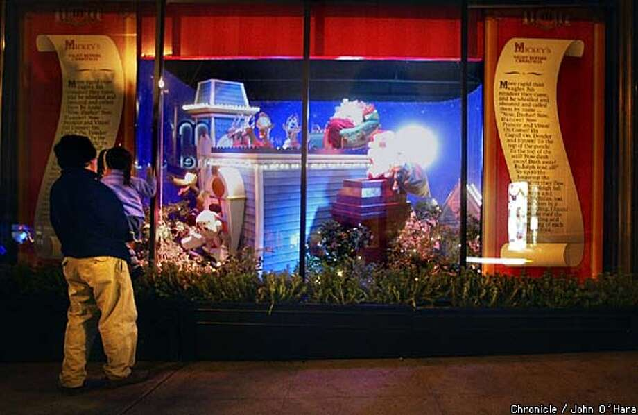 "The downtown Macy's window displays tell the animated story of ""Mickey's Night Before Christmas,'' complete with soundtrack. It's the story's third year at Macy's. Chronicle photo by John O'Hara"