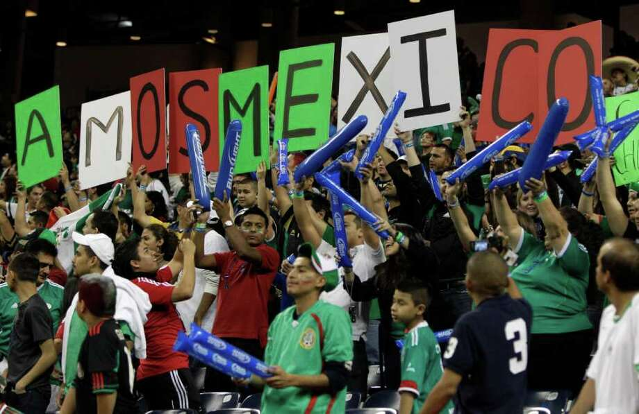 Mexico fans cheer during the first half of an international soccer friendly at Reliant Stadium Wednesday, Jan. 25, 2012, in Houston. Photo: Brett Coomer, Houston Chronicle / © 2012 Houston Chronicle