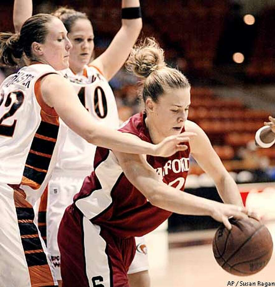Pacific's Andrea Nederostek, left, and Gillian d'Hondt, rear, guard Stanford center Chelsea Trotter during the first half Saturday, Dec. 14, 2002, in Stockton, Calif. (AP Photo/Susan Ragan) Photo: SUSAN RAGAN