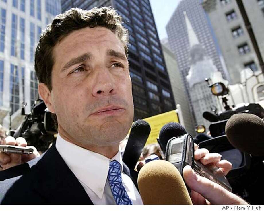 U.S. Senate candidate Jack Ryan answers questions during an appearance Tuesday, June 22, 2004, in Chicago. His candidacy in turmoil over sex club allegations, Ryan is considering quitting the race according to kowledgeable GOP officials. (AP Photo/Nam Y Huh) Photo: NAM Y HUH