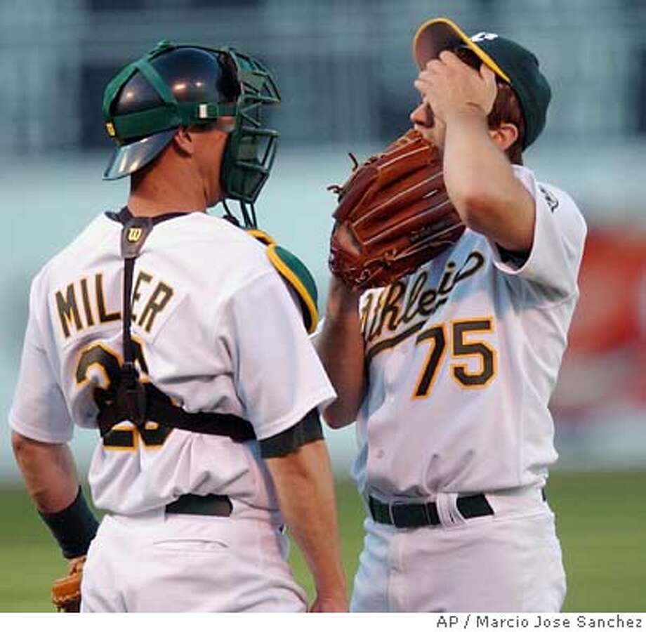 Oakland Athletics pitcher Barry Zito, right, stands on the mound with catcher Damian Miller after giving up a solo home run to San Francisco Giants' Pedro Feliz during the first inning Friday, June 25, 2004, in Oakland, Calif. The Giants scored five runs in the inning. (AP Photo/Marcio Jose Sanchez) Photo: MARCIO JOSE SANCHEZ