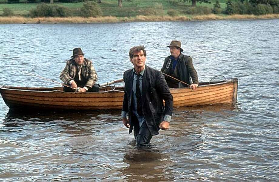 "Pluck of the Irish: A laborer (Pierce Brosnan) deserted by his wife battles for custody of his children in ""Evelyn."""
