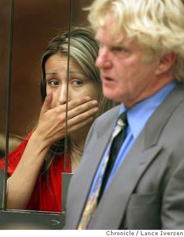 CHASXEDIE26_110_LI.JPG event on 6/25/04 in HAYWARD Laura Medina stands behind a glassed wall as she was arraigned at the Hayward Hall of Justice on a charge of murder for allegedly ramming a car containing her boyfriend - and his new girlfriend Michelle Dickerson who was killed in a high-speed accident. Medina�s attorney Fred Remer asked for a continuance before making aplea. By Lance Iversen/San Francisco Chronicle Photo: Lance Iversen