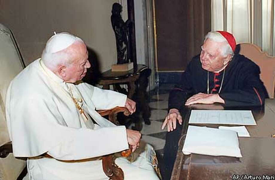 Pope John Paul II, left, meets with Cardinal Bernard Law in a private audience at the Vatican Friday, Dec. 13, 2002. Law resigned Friday as Boston archbishop, finally bowing to months of public outrage that he failed to protect children from molesters in the clergy.(AP Photo/Arturo Mari) Photo: ARTURO MARI