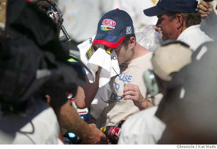 #24 Jeff Gordon with team DuPont Chevrolet takes several minutes to recover from the grueling race and being over heated in the winner's circle after he wins the Dogde Save Mart 350, NASCAR Nextel Cup auto race at the Infineon Raceway in Sonoma on 6/27/04 . Kat Wade/The Chronicle Photo: Kat Wade