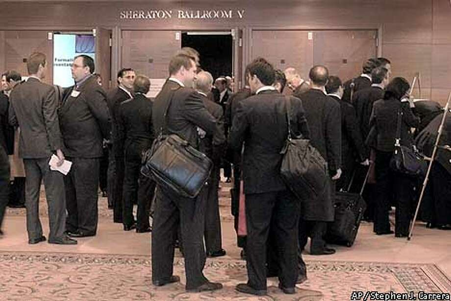 Representatives of some of the United Airlines creditors wait outside a ballroom at the Sheraton Hotel in Chicago, Friday, Dec. 13, 2002. More than a hundred unsecured were there to meet with federal bankruptcy trustees. (AP Photo/Stephen J. Carrera) Photo: STEPHEN J. CARRERA